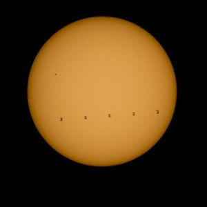 This composite image made from five frames shows the International Space Station, with a crew of nine onboard, in silhouette as it transits the sun at roughly five miles per second, Sunday, Sept. 6, 2015, Shenandoah National Park, Front Royal, VA. Onboard are; NASA astronauts Scott Kelly and Kjell Lindgren: Russian Cosmonauts Gennady Padalka, Mikhail Kornienko, Oleg Kononenko, Sergey Volkov, Japanese astronaut Kimiya Yui, Danish Astronaut Andreas Mogensen, and Kazakhstan Cosmonaut Aidyn Aimbetov. Photo Credit: (NASA/Bill Ingalls)